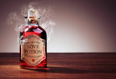 Pote de poção mágica com fumaça saindo.