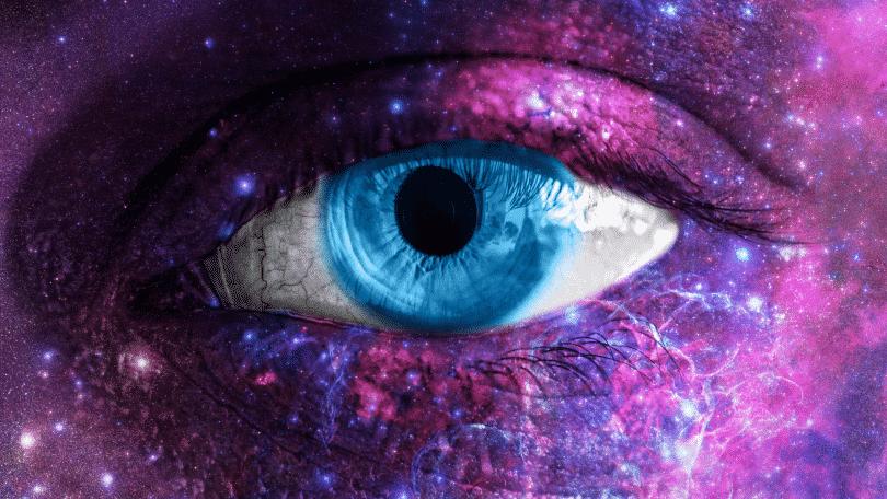 Olho humano misturado com o universo