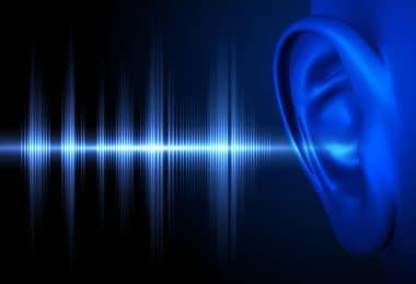 Ilustração de ondas sonoras entrando no ouvido humano.