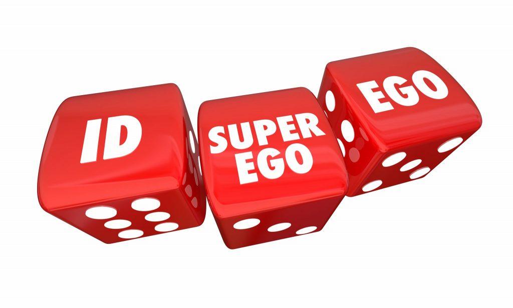 Três dados na cor vermelha. Em cada um deles está escrito na cor branca as palavras: ID, EGO E SUPER EGO.