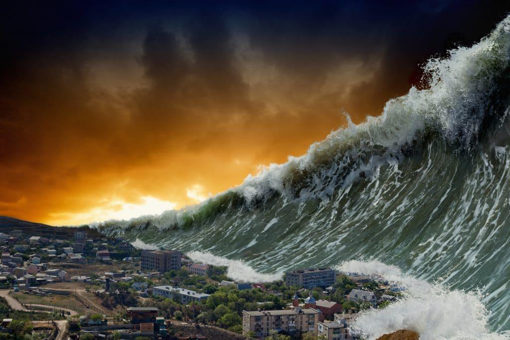 Tsunami com uma onde bem forte e grande. Ele se formou à noite e está pronto para invandir toda uma cidade.
