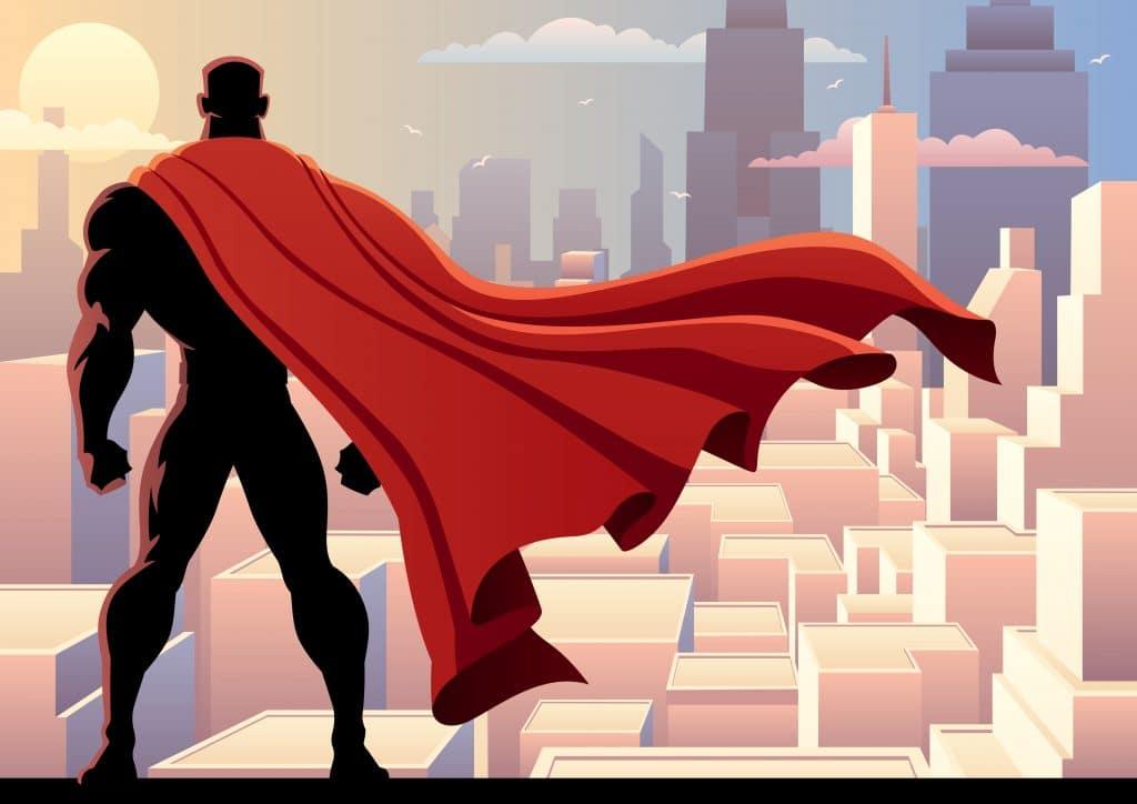 Imagem do um super herói dos quadrinhos clássicos. Ele está no alto observando a cidade de Gotan City. Ele usa uma grande capa vermelha.
