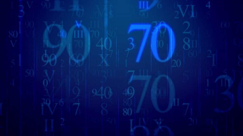 Muitos números na cor azul neon. Ao fundo um tom azul bem escuro dá o tom de destaque, iluminando os números,