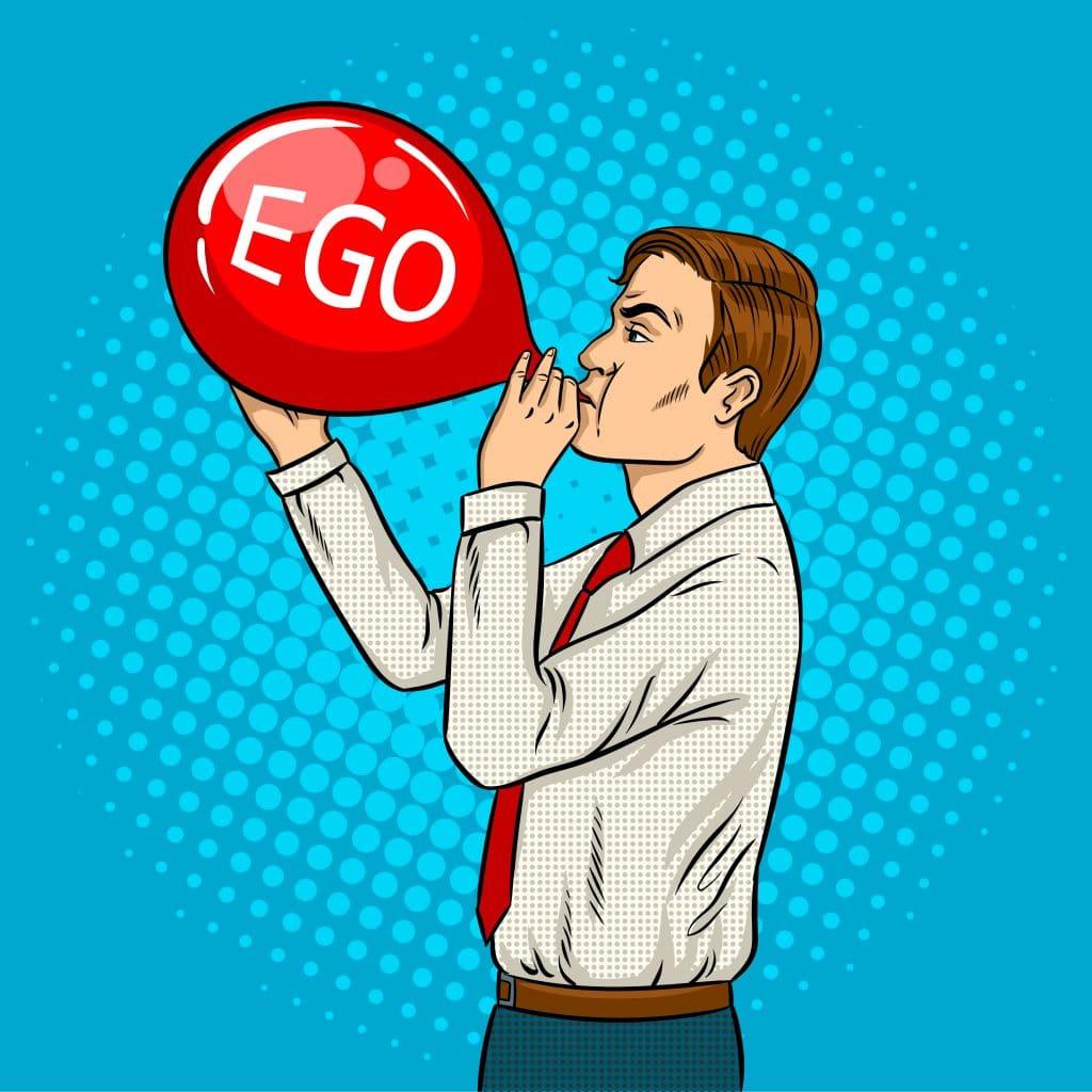 Homem enchendo uma bexiga vermelha. Na bexiga está escrito a palavra ego.