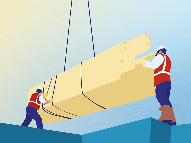 Dois trabalhadores movendo materiais para os alicerces de uma construção.