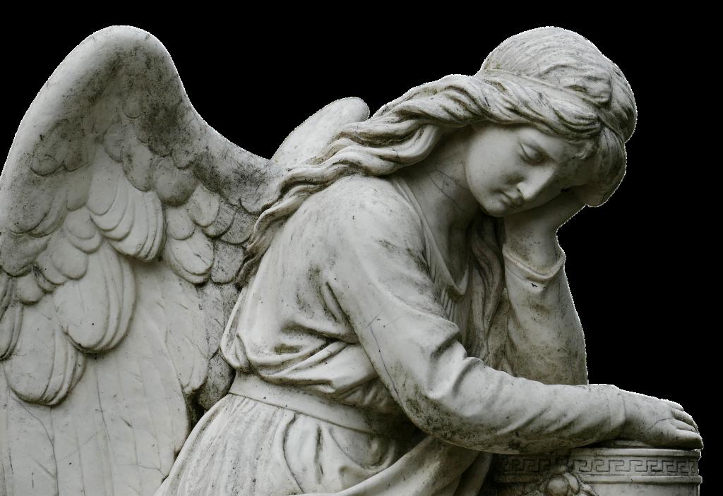 Estátua de um anjo sobre um túmulo do cemitério. Imagem preto e branco.
