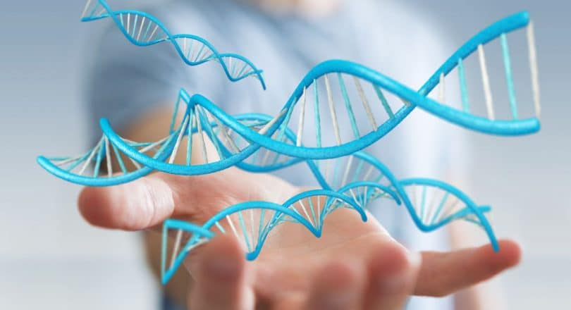 Mão aberta para cima com ícones de DNA flutuando em cima
