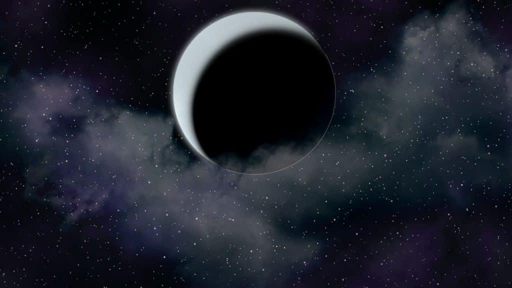 Imagem da lua nova em um céu estrelado.