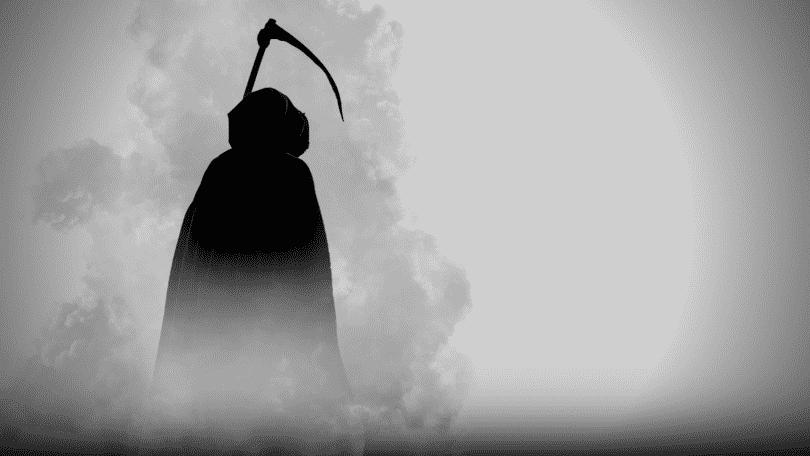 Imagem figurativa da morte de capuz segurando uma foice