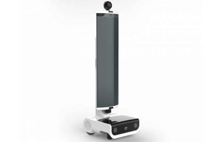 O robô T-TR1, com uma base parecida com um projetor, uma tela em forma de coluna côncava, e uma pequena câmera no topo.