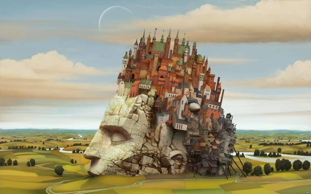 Obra do pintor surrealista Jacek Yerka, em que uma cabeça gigante de pedra serve de base para a construção de uma vila.