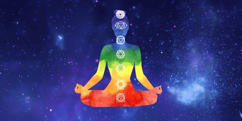 Ilustração de uma pessoa sentada com as cores dos chacras