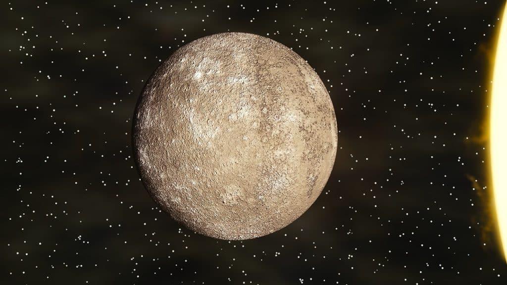 Imagem do planeta Mercúrio ao lado do Sol e das estrelas.