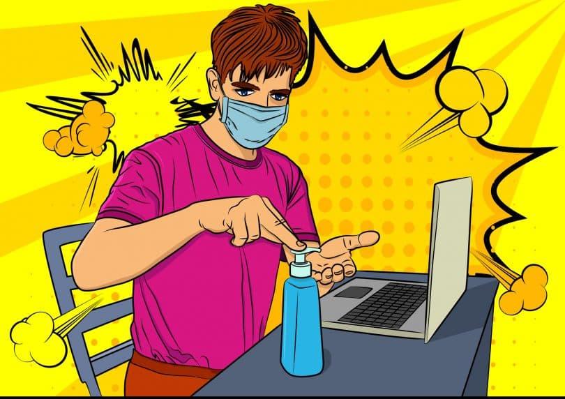 Desenho em formato de quadrinho de homem usando máscara, despejando álcool gel em suas mãos, em frente a um computador.