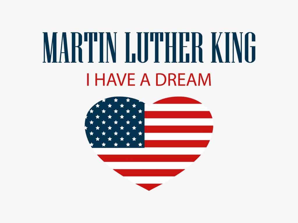 """Imagem de um coração preenchido com as cores e os símbolos da bandeira dos Estados Unidos. Sobre a imagem do coração está escrito as frases: Martin Luther King - Eu tenho um sonho""""."""