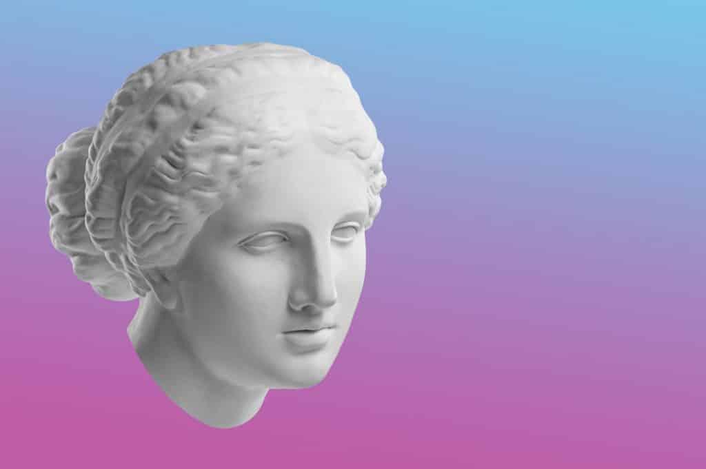 Imagem de fundo rosa e azul do rosto da deusa Afrodite.