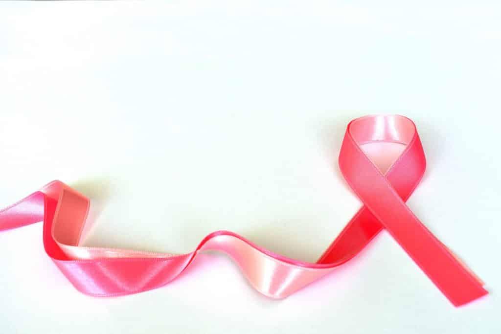 Imagem do laço rosa representando a campanha Outubro Rosa.
