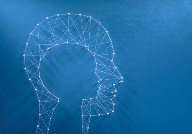 Cabeça humana feita de linhas e pontos om silhueta de cabeça de criança dentro