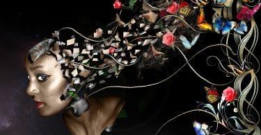 Imagem do rosto de uma pessoa. Parte da cabeça está saindo vários tipos de elementos como: flores e borboletas coloridas representando uma mente criativa, bonita e aberta ao novo, próspera para a criatividade.