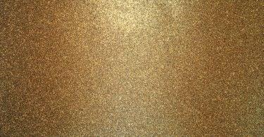 Imagem de um plano de fundo coberto com muito ouro.