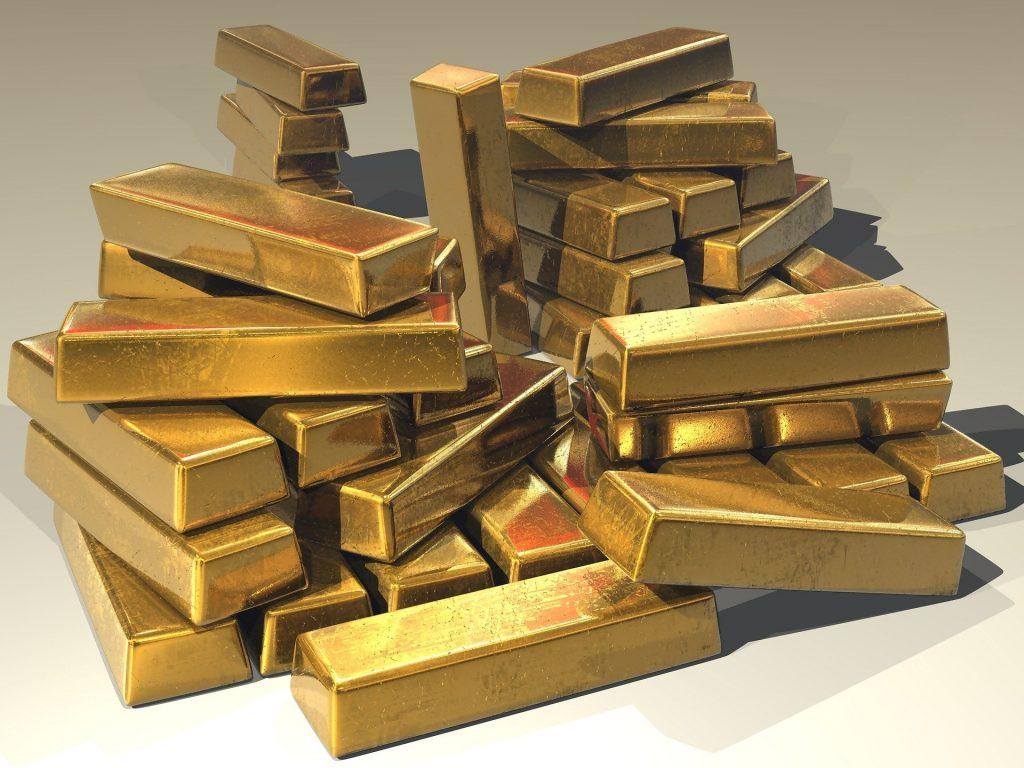 Imagem de muitas barras de ouro empilhadas.