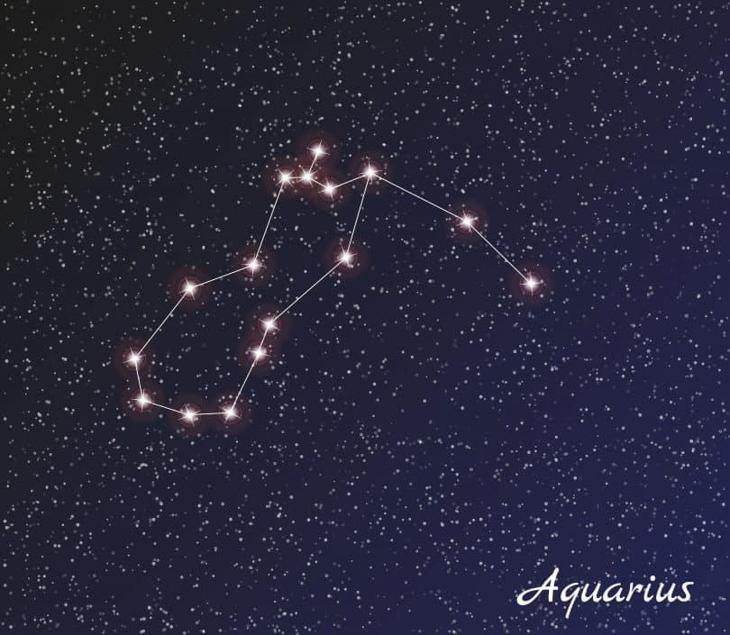 Imagem do céu estrelado e nele está desenhado o signdo de aquário com pontos de luz.
