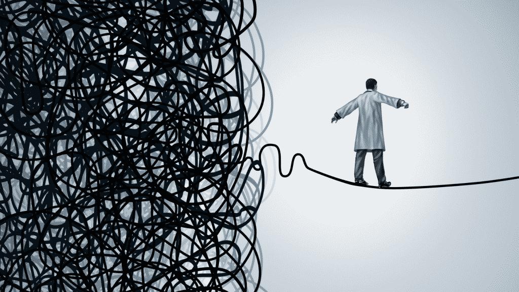 Imagem ilustrativa de um homem andando em corda bamba