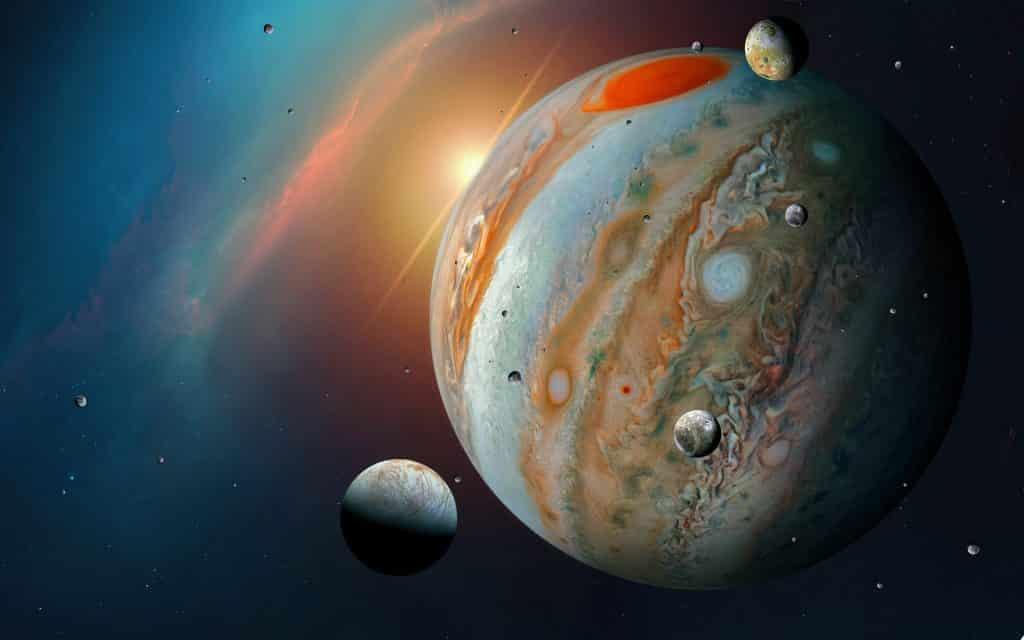 Imagem de fundo azul representando o universo. Nessa imagem temos a Lua e o Planeta Júpiter, um ao lado do outro.