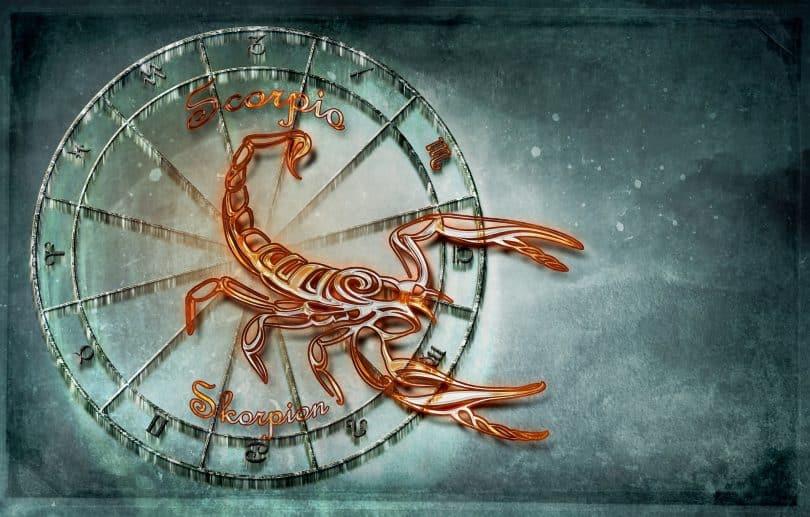 Imagem de fundo azul claro com o símbolo do signo de escorpião, sendo representado por dois animais: o próprio escorpião e a águia.