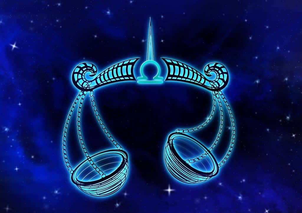 Imagem de fundo azul trazendo o símbolo do signo de libra, sendo representado por uma balança.