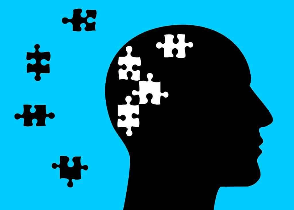 Ilustração de uma cabeça com peças de um quebra-cabeça
