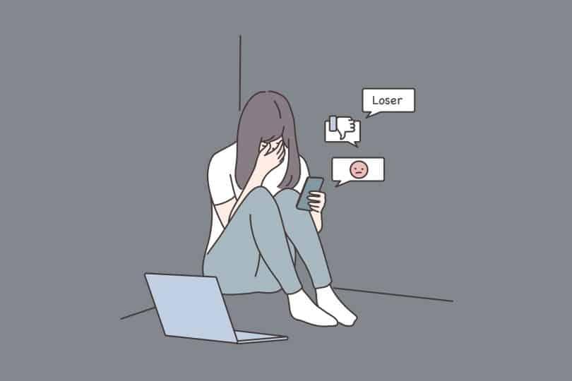 Desenho de uma menina deprimida olhando o celular.