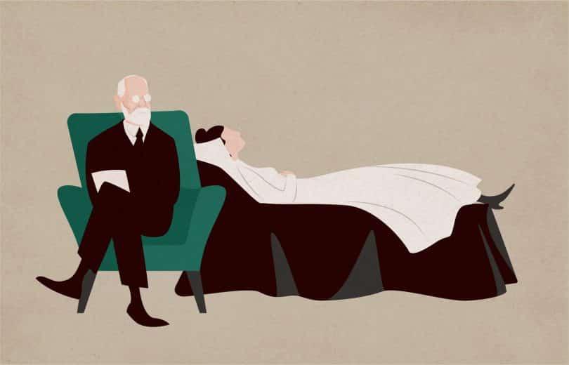 Mulher deitada no sofá e Sigmund Freud sentado na poltrona ao lado dela e fazendo perguntas.