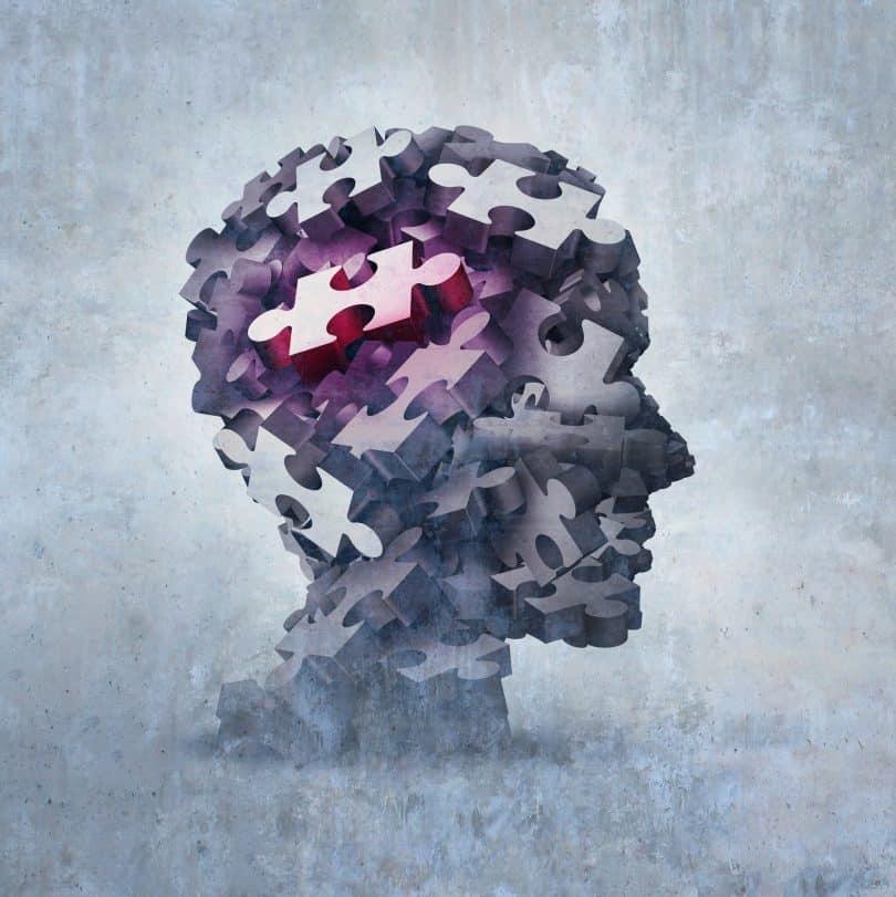 Ilustração 3D de uma cabeça humana com quebra-cabeças