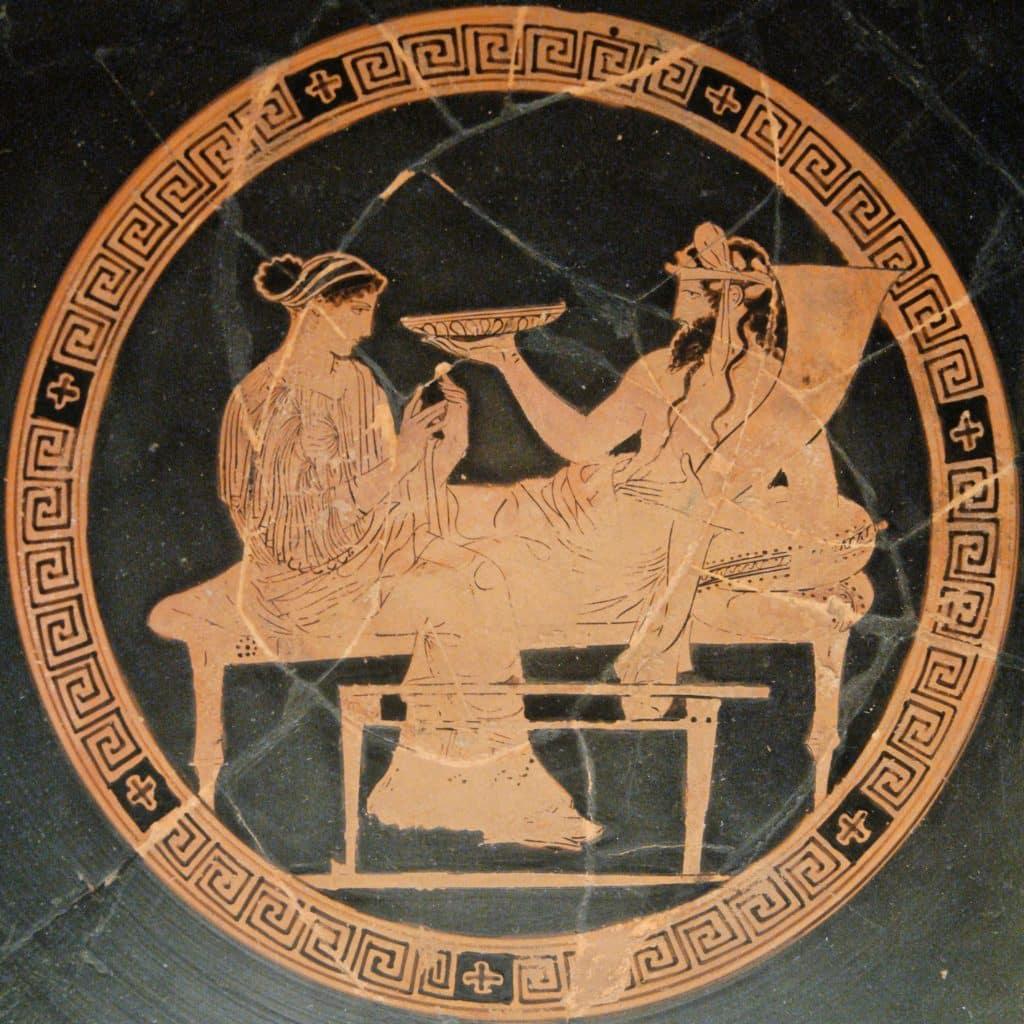 Ilustração sobre um vaso antigo. À esquerda, Perséfone. À direita Hades.