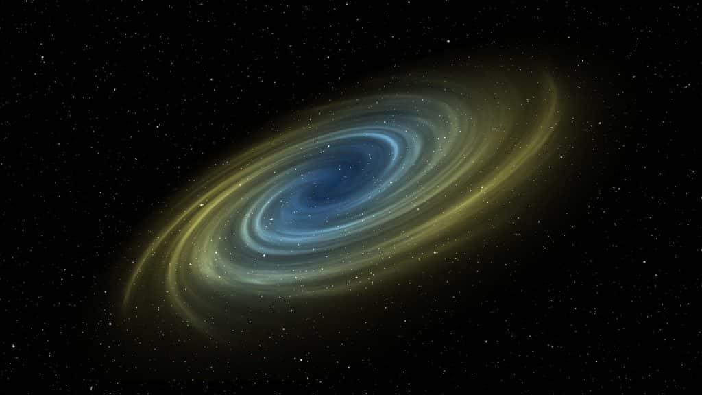 Uma galáxia com uma espiral de coloração amarela e azul.